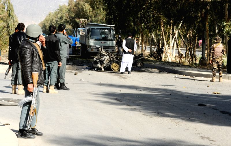 Members of Afghan security forces inspect the site of a suicide car bombing in Kandahar City,  capital of southern Afghanistan's Kandahar province, Jan. 18, 2015. .