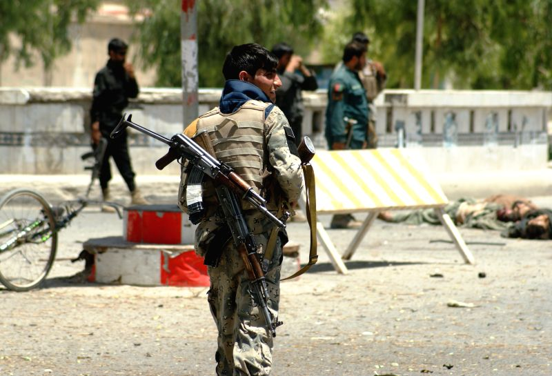 Afghan soldiers inspect the site of an attack in Kandahar province in southern Afghanistan, July 9, 2014. Massive attacks, including suicide bombings,launched by ...