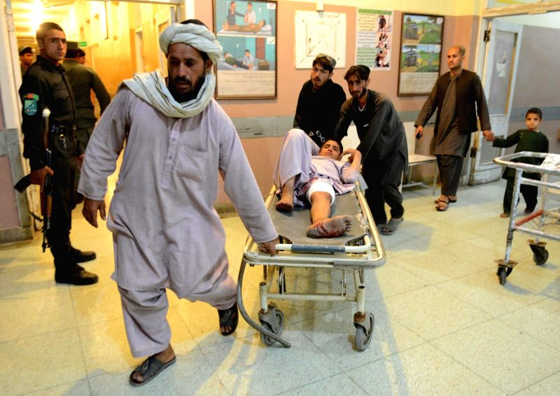 KANDAHAR, May 17 People carry an injured man at a local hospital in Kandahar province, Afghanistan, May 16, 2017. One civilian was killed and one dozen people wounded after a twin blasts ...