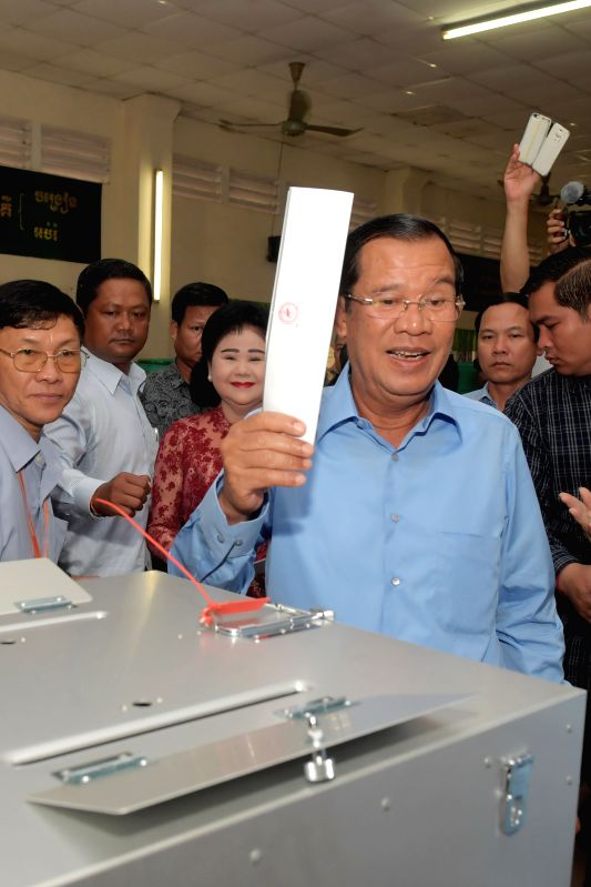 KANDAL, July 29, 2018 - Cambodian Prime Minister Samdech Techo Hun Sen (Front) prepares to cast his ballot at a polling station in Kandal, Cambodia, on July 29, 2018. The sixth general election ... - Samdech Techo Hun Sen