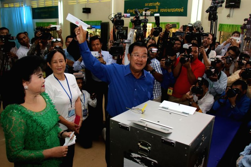 KANDAL, June 4, 2017 - Cambodian Prime Minister Samdech Techo Hun Sen (C) shows his ballot during the commune election in Kandal province, Cambodia, on June 4, 2017. The commune elections kicked off ... - Samdech Techo Hun Sen
