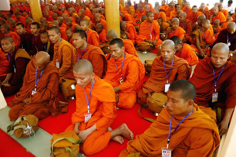 Buddhist monks attend a religious ceremony on the Visak Bochea Day, or Lord Buddha's Day, in Kandal province, Cambodia, May 13, 2014. Hundreds of Buddhist monks and ..