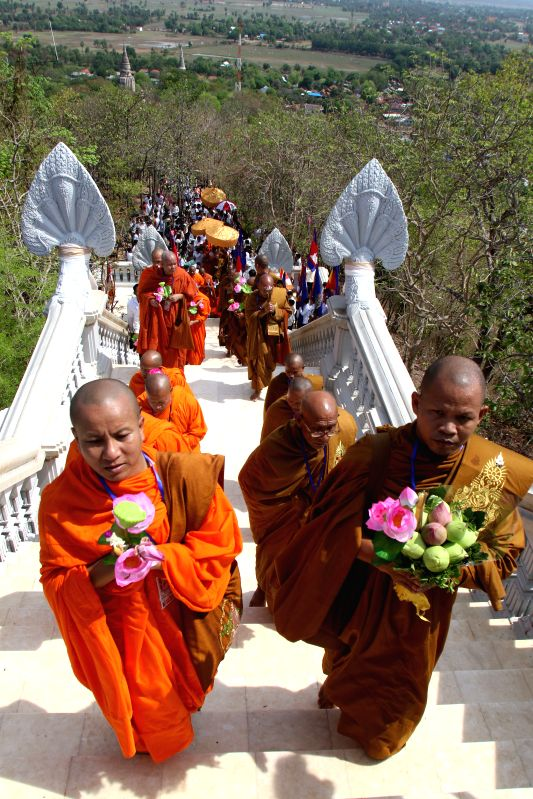 KANDAL, May 20, 2016 - Buddhist monks and laypeople attend the procession of Buddha relics at Oudong Mountain in Kandal province, Cambodia, on May 20, 2016. A golden urn containing relics of the ...
