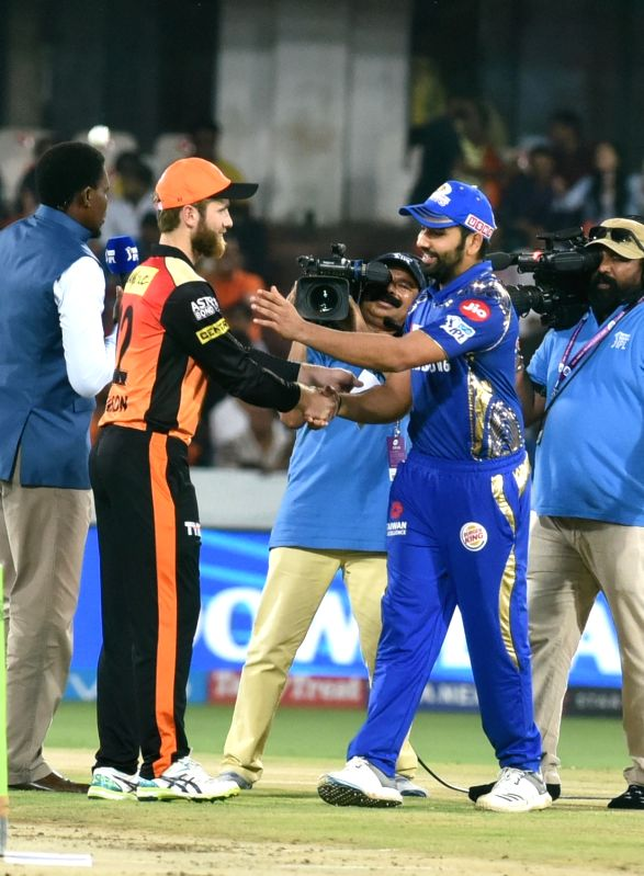 Kane Williamson of Sunrisers Hyderabad and Rohit Sharma Mumbai Indians of during the toss ahead of an IPL 2018 match at Rajiv Gandhi International Cricket Stadium in Hyderabad on April 12, ...