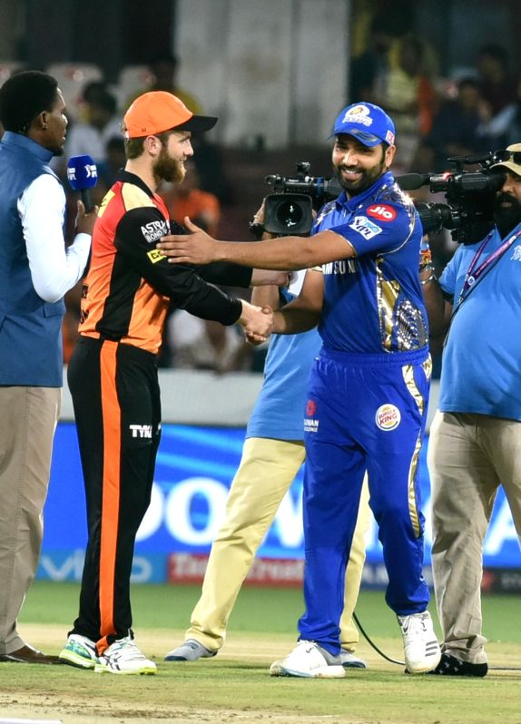 Kane Williamson of Sunrisers Hyderabad and Rohit Sharma Mumbai Indians of during the toss ahead of an IPL 2018 match at Rajiv Gandhi International Cricket Stadium in Hyderabad on April 12, ...