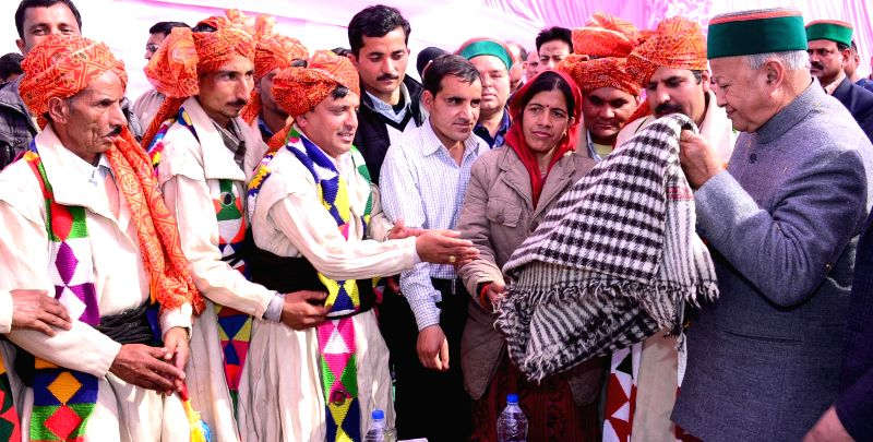 Himachal Pradesh Chief Minister Virbhadra Singh being greeted by representatives of Gaddi community on his arrival at Rait in Kangra district of the state on Feb 12, 2015. - Virbhadra Singh