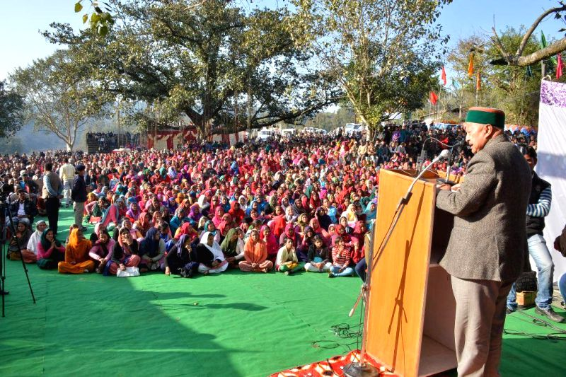 Himachal Pradesh Chief Minister Virbharda Singh addresses during a programme organised in Kangra district of Himachal Pradesh on Jan 12, 2015.