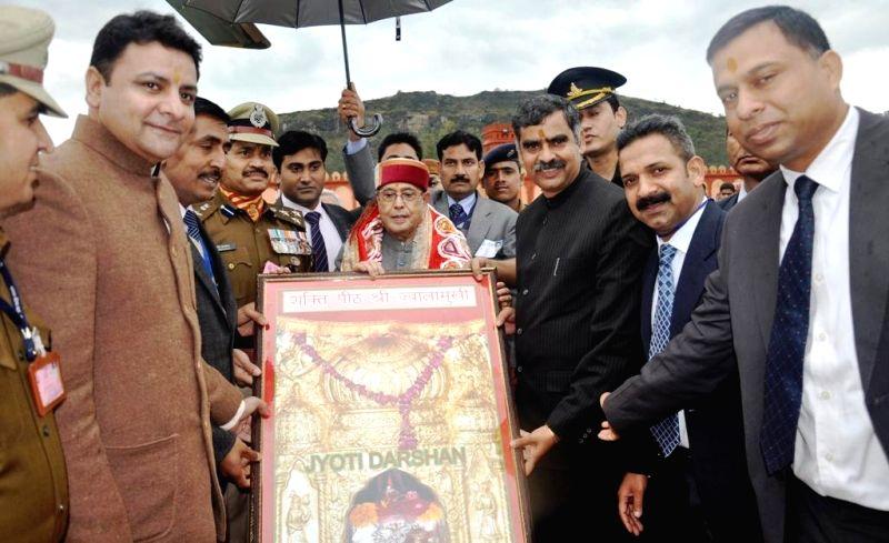 President Pranab Mukherjee being welcomed by Himachal Urban Development Minister Sudhir Sharma, at Sapri near Jawalamukhi in Kangra district of Himachal on March 15, 2015. - Sudhir Sharma and Pranab Mukherjee
