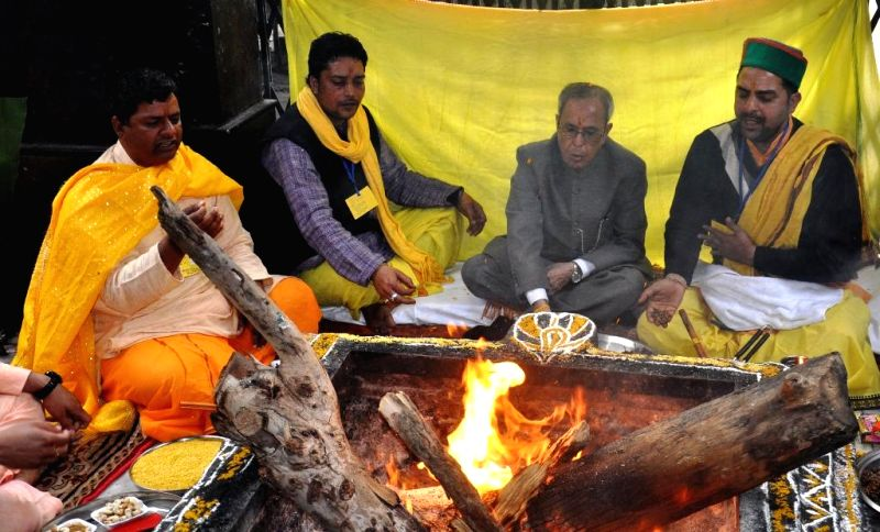 President Pranab Mukherjee participates in a yagna at the Baglamukhi temple in Kangra district of Himachal on March 15, 2015. - Pranab Mukherjee