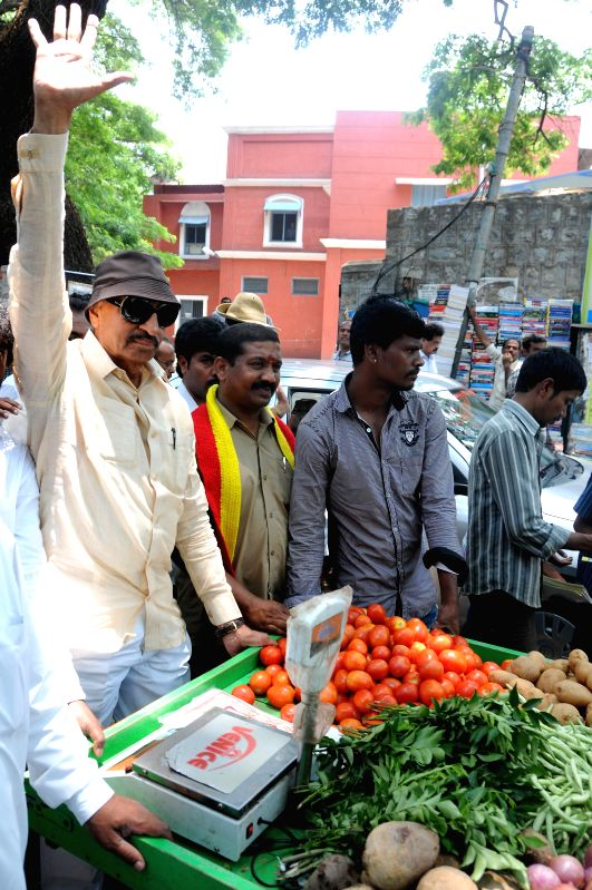 Kannada Chalavali Vatal Paksha president Vatal Nagaraj with party's candidate from Bangalore Central, Manjunath sell vegetables during an election campaign in Bangalore on April 11, 2014.