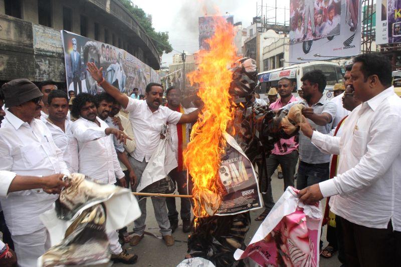 Kannada Chaluvali Vatal Paksha members led by its President Vatal Nagaraj protest against the release of Non Kannada movies in Karnataka at Nataraja Theatre, in Bengaluru on July 22, 2016.