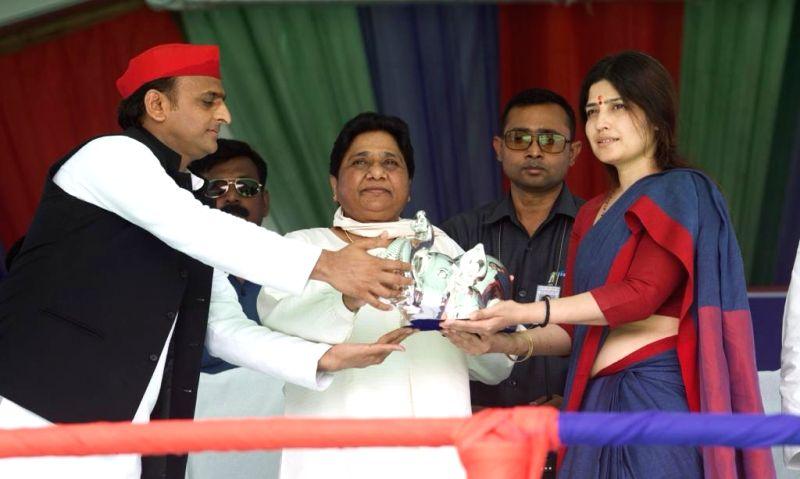 Kannauj: Samajwadi Party President Akhilesh Yadav, Bahujan Samaj Party (BSP) supremo Mayawati and SP's Lok Sabha candidate from Kannauj, Dimple Yadav during SP-BSP-RLD joint public rally in Uttar Pradesh's Kannauj, on April 25, 2019.