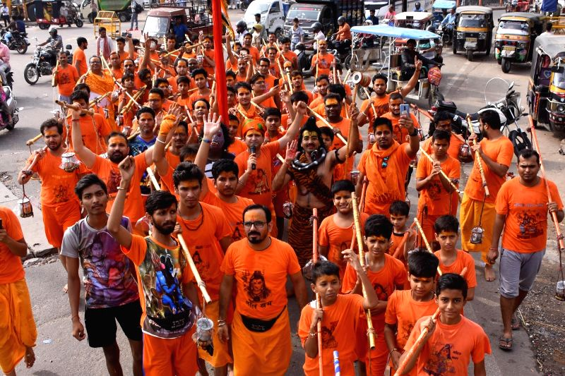 Kanwariyas - devotees - during their pilgrimage to worship Lord Shiva in the holy month of Shravan also known as Sawan, in Jaipur, on July 29, 2018.