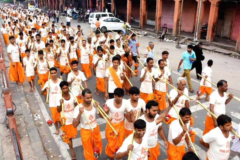 Kanwariyas - devotees of lord Shiva- carry holy water from Galtaji to offer it at Shiv temple in Jaipur, on Aug 7, 2016.