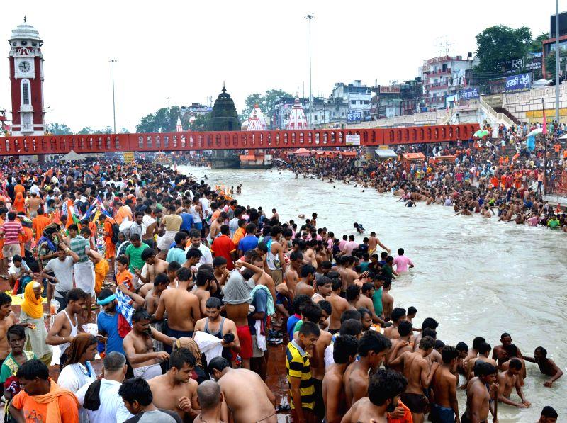 Kanwariyas -pilgrims- at Har Ki Pauri in Haridwar on July 29, 2016.