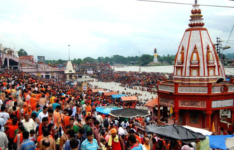 Kanwariyas taking holy dip and collecting holy Ganga water at Har Ki Pauri in Haridwar on July 24, 2014.