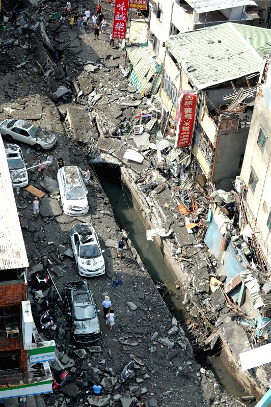 Photo taken on Aug. 1, 2014 shows destroyed roads after gas leak explosions in Kaohsiung, southeast China's Taiwan. The local fire-fighting authority said gas ...