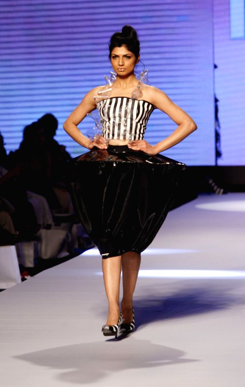 A model presents a creation by designer Shehza Azhar on the first day of Fashion Pakistan Week in southern Pakistani port city of Karachi, March 31, 2015. ...