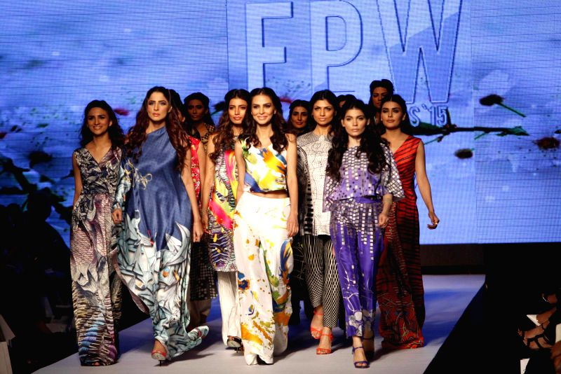 Models present creations by designer Madiha Raza on the first day of Fashion Pakistan Week in southern Pakistan's port city of Karachi, March 31, 2015. ...