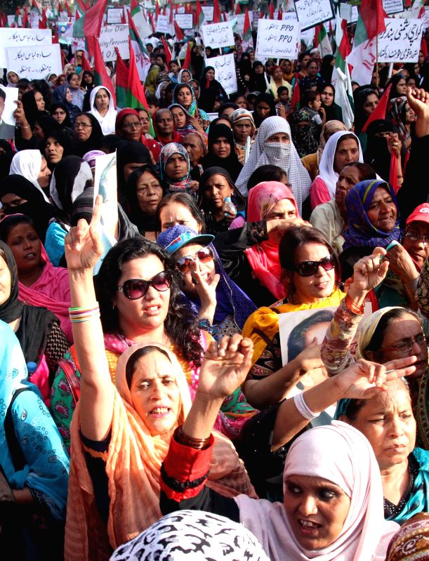People shout slogans during a protest rally against killing and disappearance of Muttahida Qaumi Movement (MQM) workers in southern Pakistani port city of Karachi,