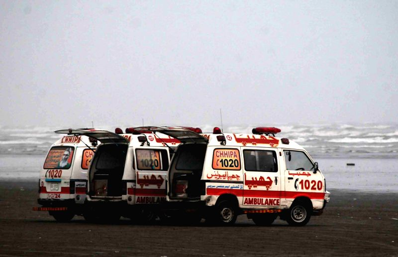 Ambulances are seen during a search operation for drowning victims over Clifton beach in southern Pakistani port city of Karachi on July 31, 2014. The bodies of ...