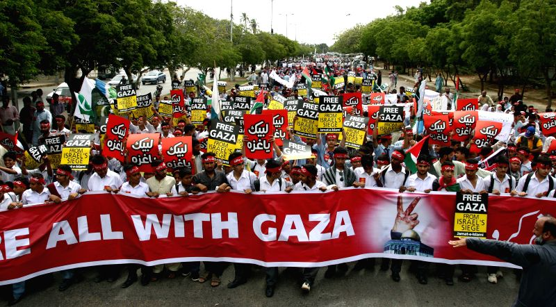 Pakistani students march during a demonstration against Israeli military operations in Gaza, organized by the Islamic political party Jamaat-e-Islami, in southern ..