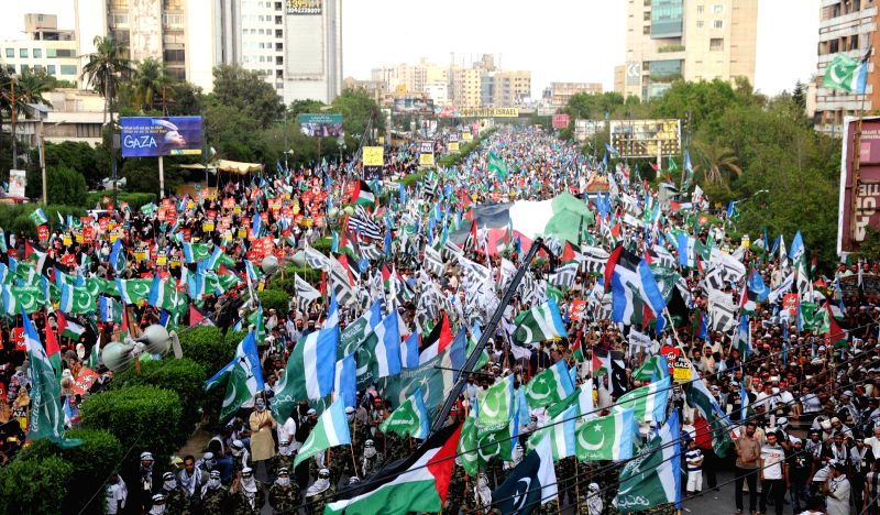 Pakistan activists from the Jamaat-e-Islami party take part in a pro-Palestinian demonstration against Israel's military campaign in Gaza, in southern Pakistani ...