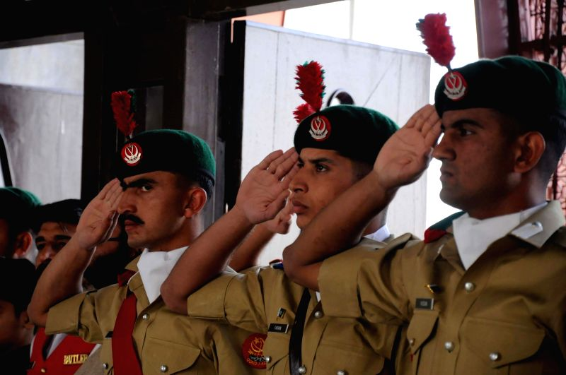 Pakistani cadets attend a ceremony on the 138th birth anniversary of Pakistan's founder Mohammad Ali Jinnah at his mausoleum in southern Pakistani port city of ...