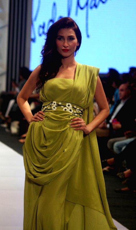 A model presents a creation by Pakistani designer Nida Tapal at Expo Pakistan Fashion Show 2015 in southern Pakistani port city of Karachi on Feb. 27, 2015. ...