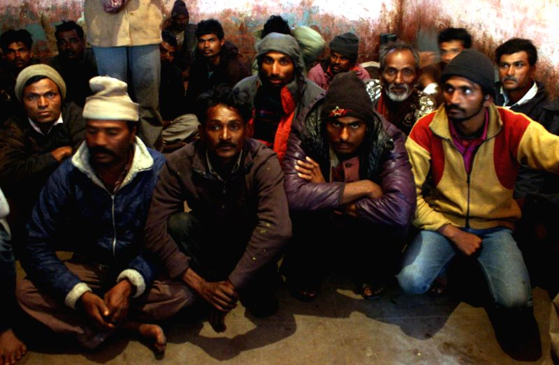 Arrested Indian fishermen sit at a police station in southern Pakistani port city of Karachi, Jan. 22, 2015. Pakistani marine forces have arrested 38 Indian ...