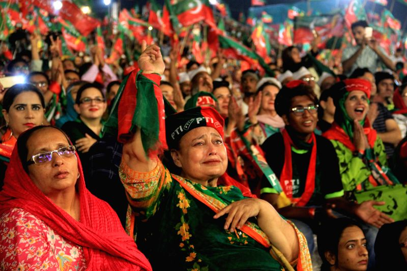 KARACHI, July 22, 2018 - Supporters of Imran Khan, chief of the Pakistan Tehreek-e-Insaf (PTI) party, attend an election campaign rally in southern Pakistani port city of Karachi, July 22, 2018. ... - Imran Khan