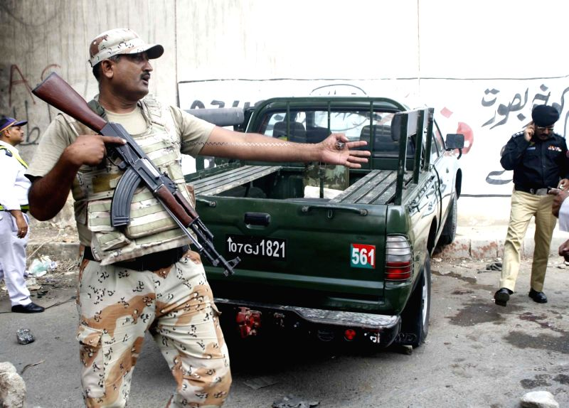 KARACHI, July 26, 2016 - Pakistani soldiers gather around an army vehicle at the site of an attack in southern Pakistani port city of Karachi on July 26, 2016. At least two soldiers of Pakistani army ...
