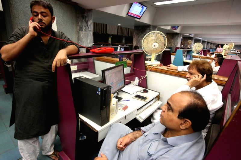 KARACHI, July 26, 2018 - Pakistani stockbrokers work at the Pakistan Stock Exchange in southern Pakistani port city of Karachi on July 26, 2018. The Pakistan Stock Exchange (PSX) regained the ...