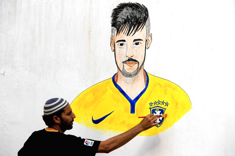 KARACHI, June 14, 2018 - An artist paints a picture of a footballer ahead of the FIFA World Cup 2018 in south Pakistani port city of Karachi on June 13, 2018.