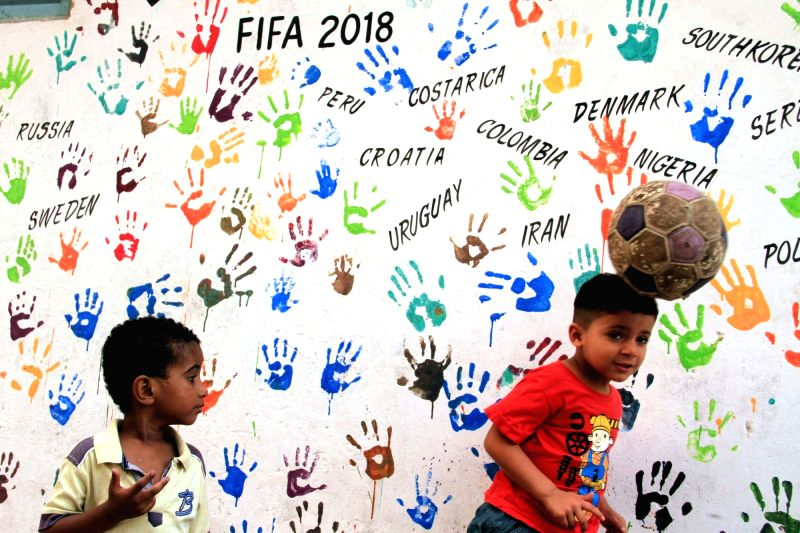 KARACHI, June 14, 2018 - Children play with a football ahead of the FIFA World Cup 2018 in south Pakistani port city of Karachi on June 13, 2018.