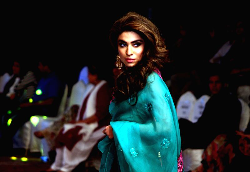 A model presents a creation by designer Maria B on the first day of South Asian Fashion Week in southern Pakistani port city of Karachi on March 10, 2015. ...