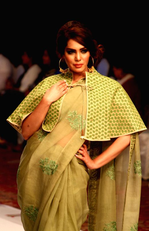A model presents a creation by Pakistani designer Maheen Kha during the South Asian Fashion Week in southern Pakistani port city of Karachi, on March 10, 2015. ...
