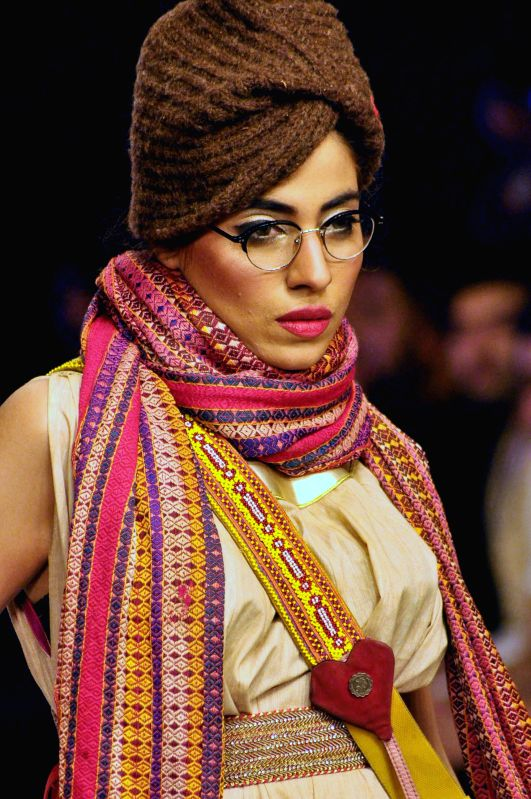 A model presents a creation by designer Yousuf Bashir Qureshi (YBQ) on the last day of South Asian Fashion Week in southern Pakistani port city of Karachi on March ...