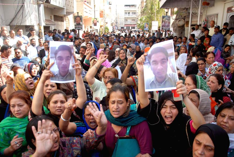 Pakistani supporters of Muttahida Qaumi Movement (MQM) shout slogans as they gather outside the MQM headquarters following a raid by paramilitary rangers in ...