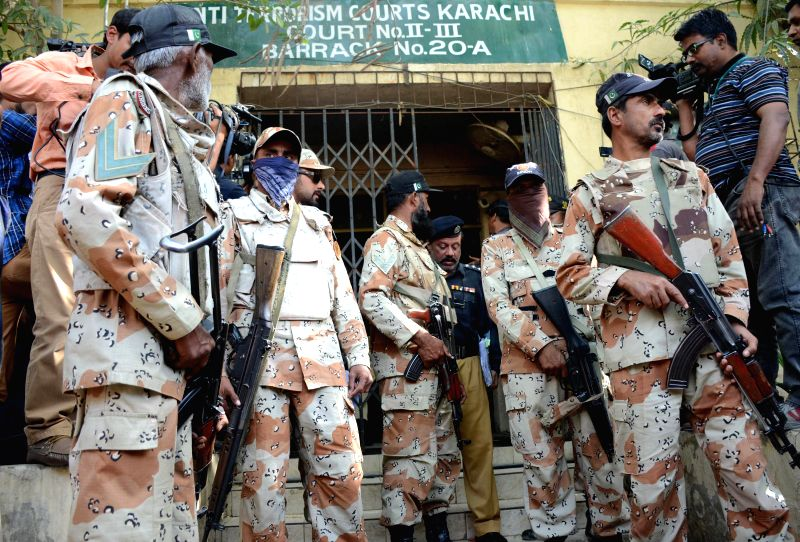 Pakistani paramilitary soldiers stand guard outside a court in southern Pakistani port city of Karachi on March 12, 2015. An anti terrorism court on Thursday ...