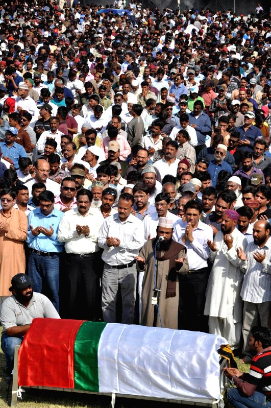 Supporters of Muttahida Qaumi Movement (MQM) and relatives attend the funeral of MQM worker Waqas Ali Shah killed in a paramilitary raid on MQM headquarters, in ... - Waqas Ali Shah