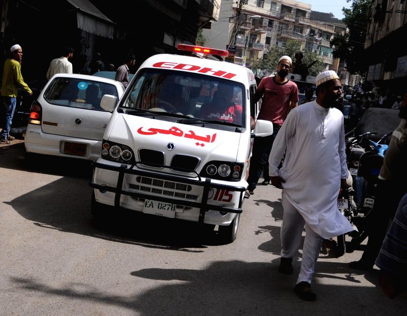 An ambulance arrives at the bomb blast site in southern Pakistani port city of Karachi, March 20, 2015. At least two people were killed and seven others injured ...