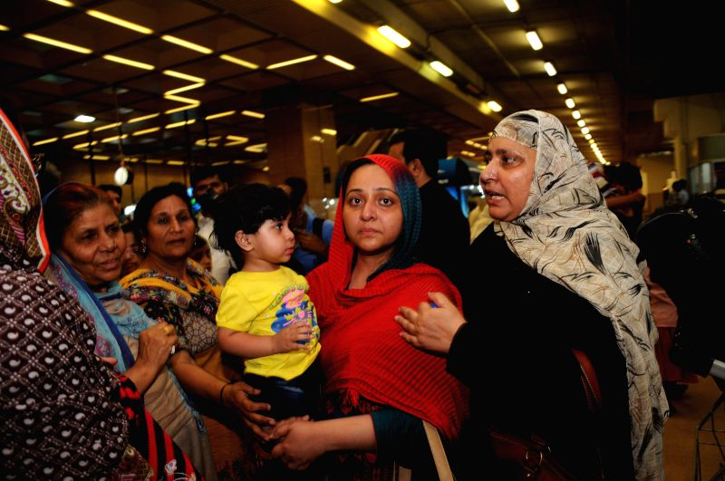 Pakistanis arrive at the Jinnah International Airport in southern Pakistani port city of Karachi on March 30, 2015. Pakistan on Sunday started evacuation of its ...