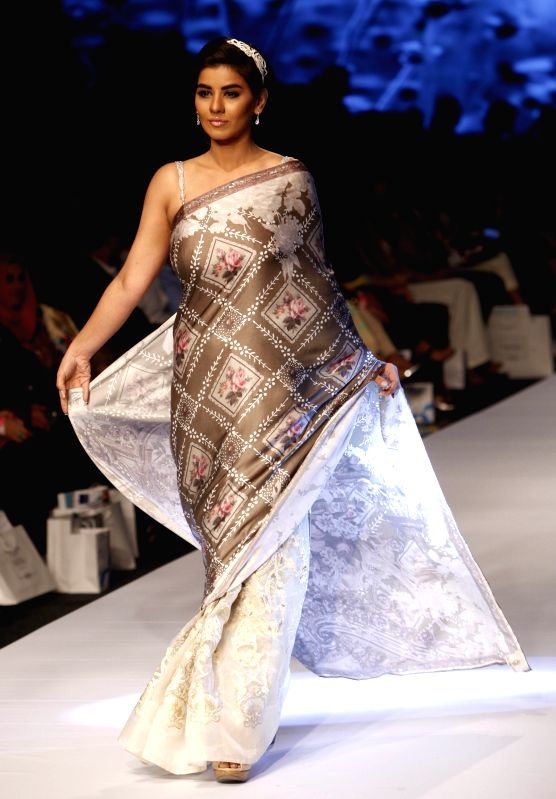 A model presents a creation by designer Madiha Raza on the first day of Fashion Pakistan Week (FPW) in southern Pakistani port city of Karachi on March 31, 2015. ...