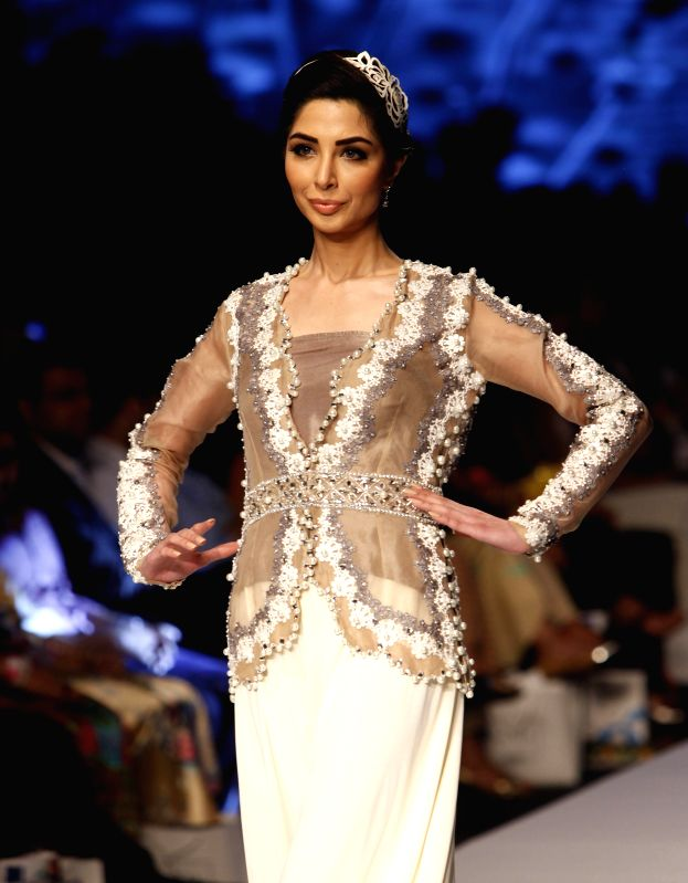 A model presents a creation by designer Nida Azwer on the first day of Fashion Pakistan Week (FPW) in southern Pakistani port city of Karachi on March 31, 2015. ...