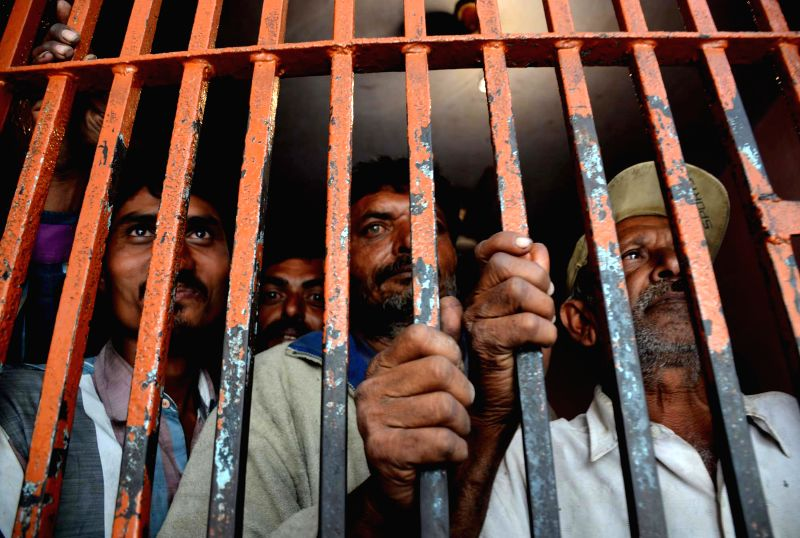 Arrested Indian Fishermen stand in a lockup at a police station in southern Pakistani port city of Karachi on March 6, 2015. Pakistani authorities on Friday ...