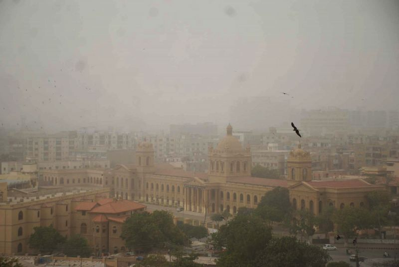 Buildings are seen covered with dust during dust storm in southern Pakistani port city of Karachi on March 7, 2015.