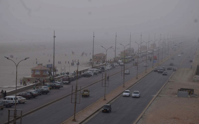 Vehicles move on road during dust storm in southern Pakistani port city of Karachi on March 7, 2015.