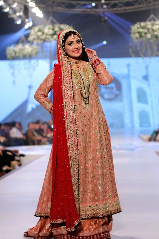 A model presents a creation by designer Sana Abbas during the first day of the Bridal couture Week in southern Pakistani port city of Karachi, May 9, 2014.