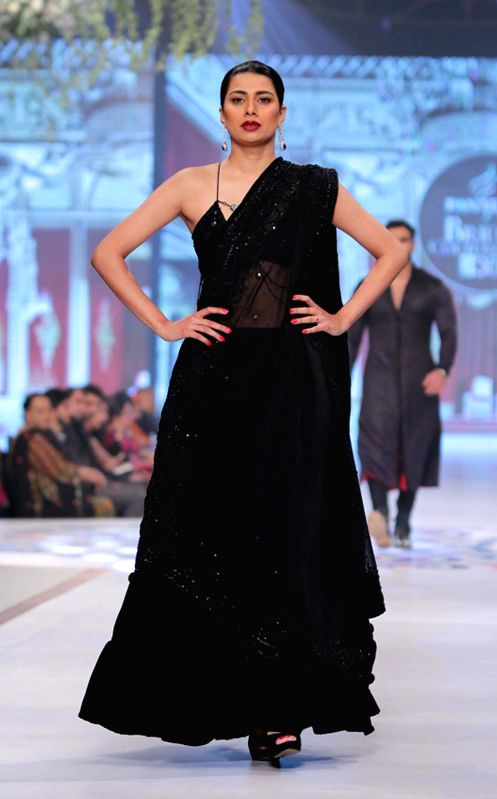 A model presents a creation by designer Mansoor Akram during the first day of the Bridal couture Week in southern Pakistani port city of Karachi, May 9, 2014.